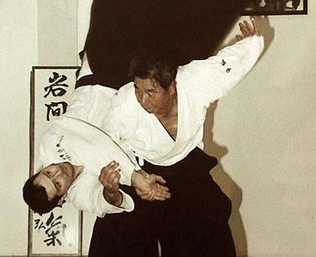 Sensei Morihiro Saito throwing a student